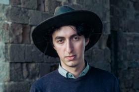 A Dutch Israeli American man wears his cowboy hat in Akko, Israel.