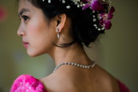 A Khmer Cambodian Wedding in Philadelphia, Pennsylvania, USA. The outfits are incredibly colorful, ornate and covered in gold jewelry and belts.