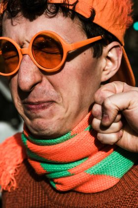 face, punch, orange, king's day, koningsdag, scarf, color, pop, fist, hat, time, perception, Amsterdam, netherlands, Dutch, photography, photo series