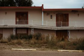 Abandoned hotel motel in New Mexico Arizona USA along Route 66 highway next to the Route 66 Diner.