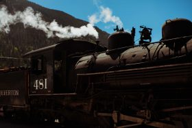The Silverton Durango Colorado Steam Train pauses at the top of the mountain in the USA.