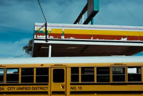 An unused yellow school bus is parked at an abandoned gas station in northern Arizona, USA.